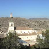 Iglesia de la Asunción y reloj de la villa